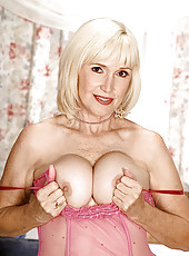 Older blonde lady in pink lingerie