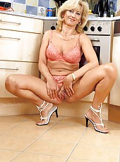 Milfie masturbating in the kitchen