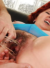 Hairy pussy stretched by a hard piece of plastic