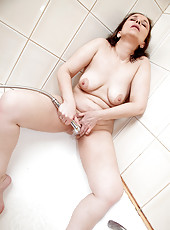 Anilos Alena fingers her wet granny pussy in the bathroom
