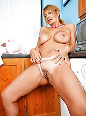 Hottie Anilos Alex slides of her thongs and spreads her sweet pink pussy indoors