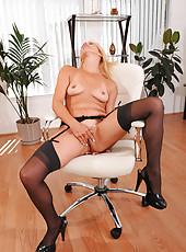 Seductive Anilos mom in sheer black lingerie masturbates in her office chair