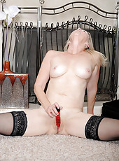 Sexy long haired Annabelle Brady slowly fucks her hot juice box with a red toy