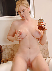 Naughty Cameron Keys pours body wash on her mature breasts and sprays her pussy with the shower head