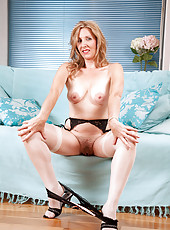 Steamy Anilos housewife spreads her legs and explores her milf pussy with her experienced fingers