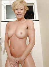 Blonde Anilos Chanel shows off her cougar tits and gets soaking wet in her bathroom