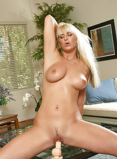 Tempting blonde Anilos coats a dildo with her sweet saliva before riding it