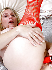Lonely housewife Jordan masturbates with a red vibrator while wearing fishnet stockings