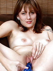 Horny cougar Justine pleasures her needy Anilos pussy with a bead toy