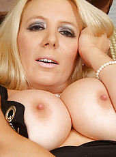 Sophisticated blonde Anilos model screws her tight matured pussy vigorously