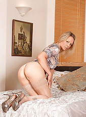 Seductive cougar Lailani fingers her mature pussy while wearing sheer stockings