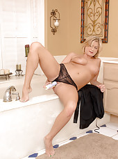 Totally nude cougar Lya Pink masturbates with a stiff dildo inside her bathroom