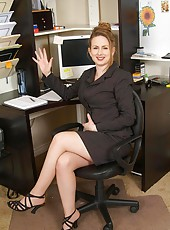 Horny secretary removes her clothes and spreads her pussy in the office