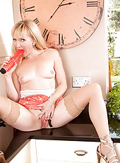 Horny blonde Anilos housewife uses a big vibrator to bang her shaved milf pussy in the kitchen