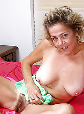 Horny Anilos Vanessa lays on her bed and gives her hairy pussy a nice vibrator drilling
