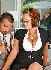 Watch hot ass delicious mega titty babe get rammed in her pussy while sucking on a hard cock in her office in this hot office group sex 3some