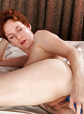 Horny soccer mom pleasures her cougar pussy using her favorite sex toys in bed