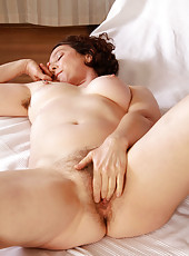 39 year old brunette Artemesia probes her hairy pussy with her fingers