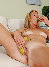 56 year old housewife Pam jams a banana into her finely aged pussy