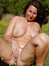 45 year old MILF Demi sets her mature tits free in the farmers field
