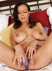 48 year old Natalie Walsh drives a blue dildo deep inside her mature hole