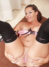 Brunette MILF Lara Martinez has fun in and out of her slinky lingerie