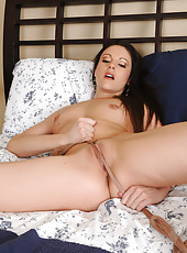 Tight bodied brunette Samantha Ryan plays with her silky nylons