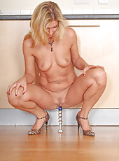 34 year old Yasmin forces a long glass dildo deep inside her hot box