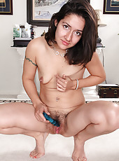 Hairy pits and pussy on Miranda slipping her glass dildo deep inside