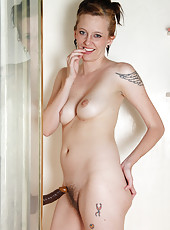 Redheaded 21 year old Alex gets jiggy with a black dildo in the shower