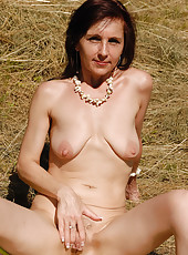 46 year old Jenny H heads into the field and spreads her ass wide