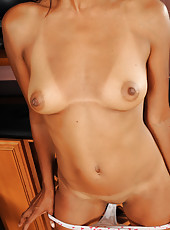 Petite and elegant Neela from All Over 30 spreads open her pussy