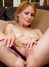 Horny MILF Tiffany T probes her mature pussy with her purple toy