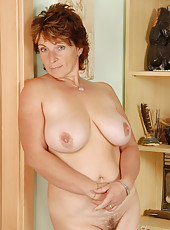 42 year old and busty Misti from AllOver30 spreading her hairy muff