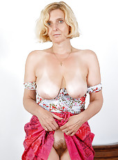 51 year old MILF Hillary shows off her natural tits and furry pussy