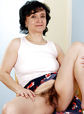 Hot grandma showing off her 52 year old hairy pussy in here