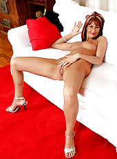 Elegant MILF Erica H strips off her evening gown and shows her puss