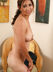 Exotic MILF Jesse from AllOver30 spreading her legs for the camera