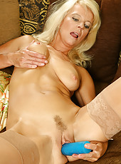 Horny blonde MILD Merilyn straddles a huge blue vibrator in here