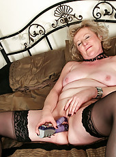 52 year old Keanne from AllOver30 sips in a hot purple dildo