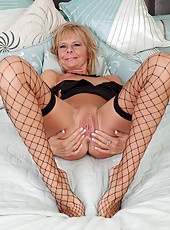 Old pornstar Cathy Oakley in black fishnet stocking show her burger