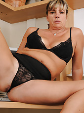 Office MILF Fire Fly from AllOver30 probes at her mature pussy