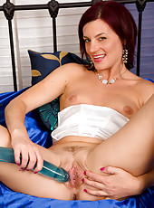38 year old MILF Sofia pushes a large blue dildo into her mature pussy