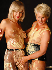 A couple hot MILF get messy and then get it on with each other