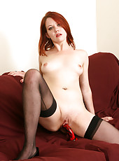 Redheaded MILF Lilla Katt pushes a red dildo deep into her vagina