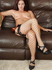 Horny 39 year old Xena poses in hot tight fishnet stockings in here