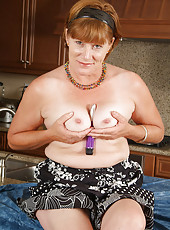 Horny grandma stabs at her older hairy pussy with a new vibrator