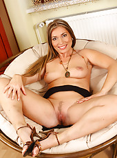 Happy and horny blonde MILF spreading her legs on the couch