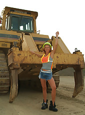 Petite MILF spreads her legs outside with the construction tractors