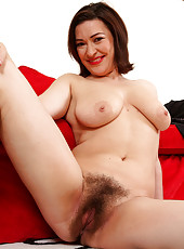 Elegant 34 year old Laura K strips and spreads her dark hairy muff